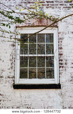 Old Window On Whitewashed Brick House
