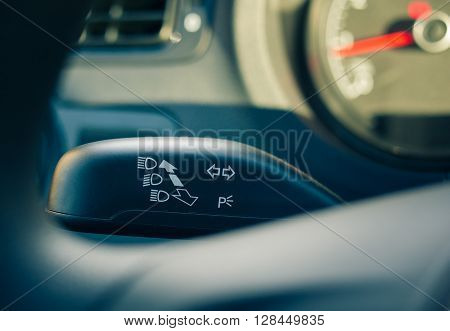 Turn signal seen behind the steering wheel closeup