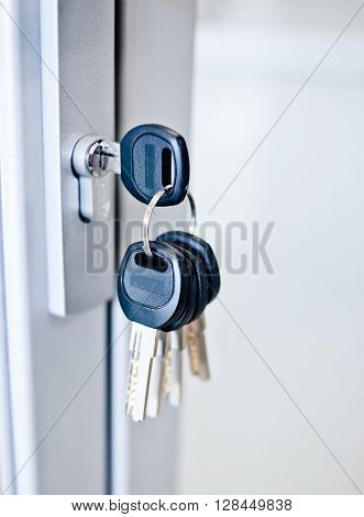 bunch of keys in a keyhole closeup