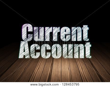 Currency concept: Glowing text Current Account in grunge dark room with Wooden Floor, black background