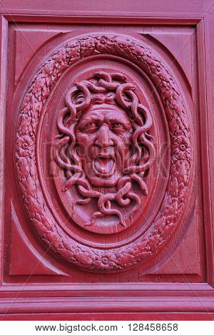 Detail of an old door in Paris representing the gorgon Medusa