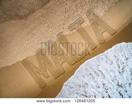 Malta written on the beach