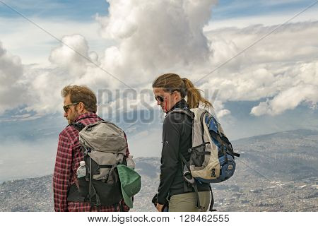 Young Couple Of Hikers At The Top Of Mountain
