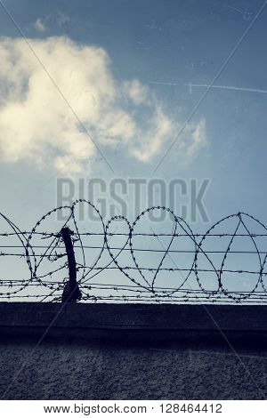 Filtered Vintage Picture Of Barbed Wire Prison Fence Detail