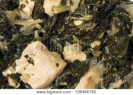 Close-up photo about chicken with mangold and spinach.