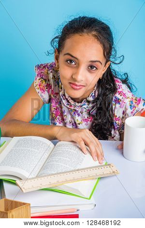 indian girl studying, cute little indian girl doing home work, asian girl studying
