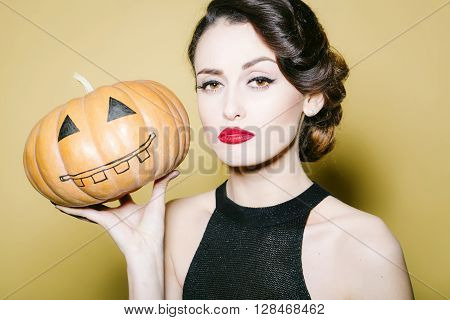 Young Woman With Halloween Pumpkin