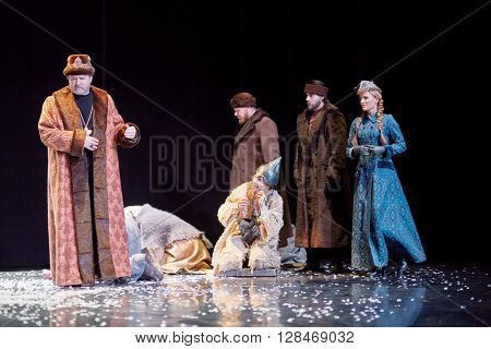 MOSCOW, RUSSIA - JAN 15, 2015: Tsar Boris, group of boyars and God fool on square in front od Cathedral on stage of Moscow theatre Et Cetera in play Boris Godunov directed by Peter Stein.
