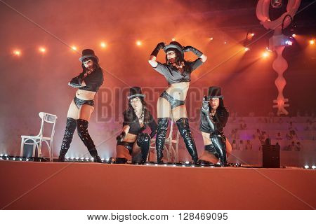 RUSSIA, MOSCOW - JUN 12, 2015: Group of  young women performs on stage of Olympiysky sports complex during Sensation Wicked Wonderland show.