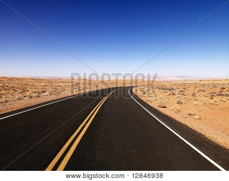 Scenic landscape of desert highway in rural Arizona, United States.