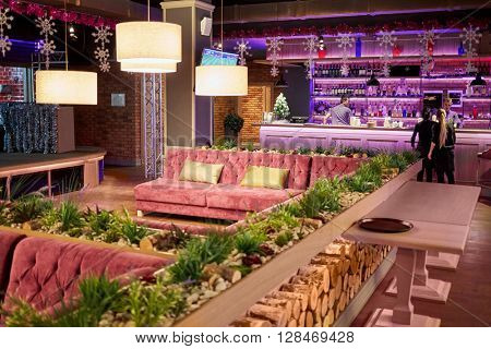 RUSSIA, MOSCOW - DEC 28, 2014: Bar counters and visitors in the restaurant Siren (Lilac), located in Sokolniki park at Pesochnaya alley.