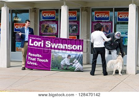 SHAKOPEE, MINNESOTA - APRIL 30, 2016: Supporters of Minnesota State Attorney General Lori Swanson hold a banner at local Democratic Party convention in Shakopee on April 30, 2016.