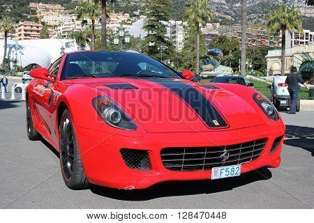 Monte-Carlo Monaco - March 9 2016: Red Ferrari 430 Scuderia Parked in Front of the Monte-Carlo Casino in Monaco
