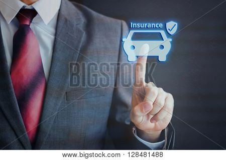 Businessman Pressing Insured Car Icon In The Air With One Finger - Car Insurance Concept