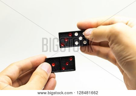 Hand Pairing Two Domino Pieces On White Isolated Background - Generating Ideas, Solving Problems Con