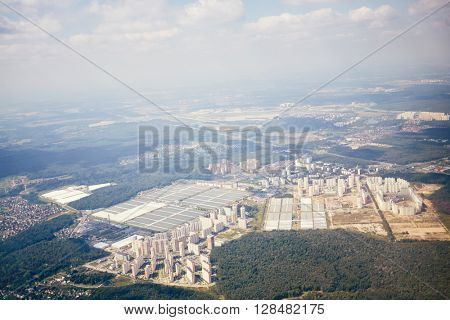 Aerial view of city from airplane that takes-off from airport.