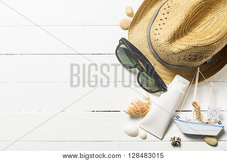 Summer holiday blackground Beach accessories on white wood table Vacation and travel items