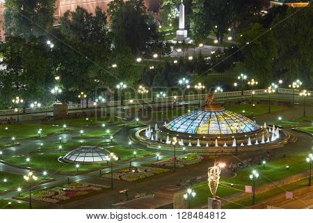 View of the Manege Square with fountains and lanterns at night.