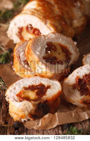 Chicken Roll Stuffed With Cheese And Sun-dried Tomatoes Close-up. Vertical