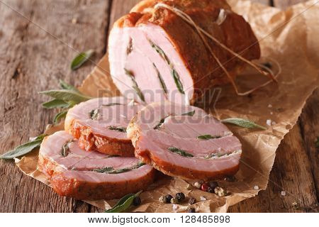 Roll Pork Stuffed With Sage Close Up On The Table. Horizontal