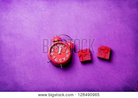 Gifts And Clock On The Table