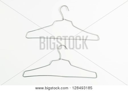 used two aluminium clothes hanger isolate on white background