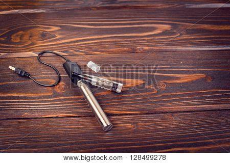 electronic nicotine inhalator on  background wood texture