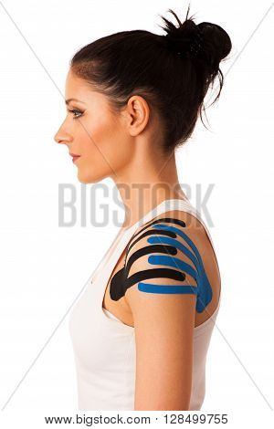 Beautiful Young Woman With Kinesiotape On Her Shoulder To Mobilise The Area After Injury