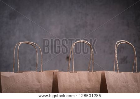 Three Craft Paper Bags Over The Greyl Background