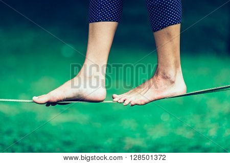 slacklining, horizontal image, side view, selective focus