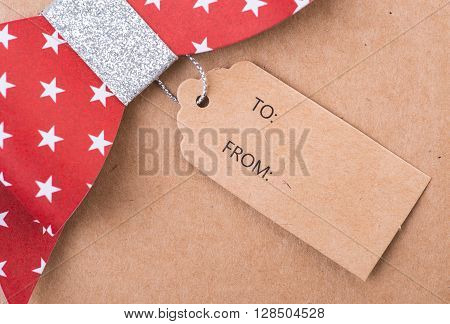Red Gift Bow With Printed Stars And Tag