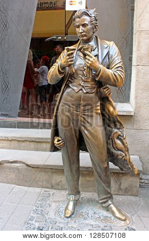 LVIV, UKRAINE - JULY 17, 2015: Statue of Leopold von Sacher Masoch near entrance of Masoch-cafe in historic city centre, Lviv, Ukraine