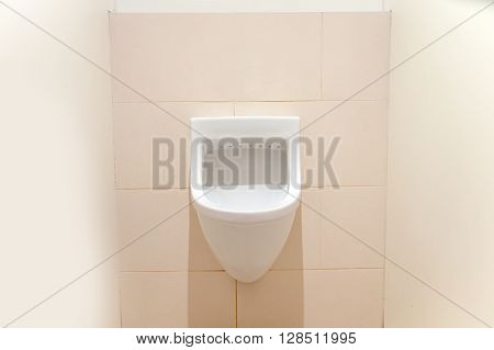 the white urinals installed at the wall