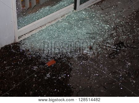 Sliding glass door that has been shattered as a home invader tried to come into a house