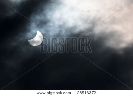 Dutovlje Slovenia. 20th March 2015. Partial solar eclipse seen through clouds over Central Europe at 14 minutes past noon CEST.