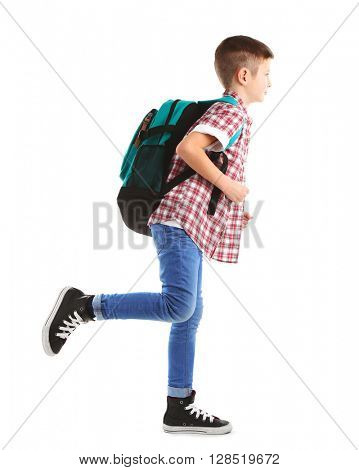Little boy with back pack running right, isolated on white