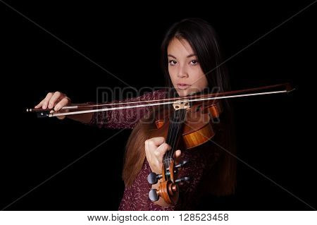 young asian woman playing violin or fiddle