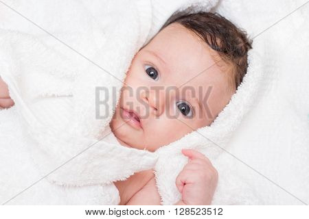 Cute baby in the white towel portrait