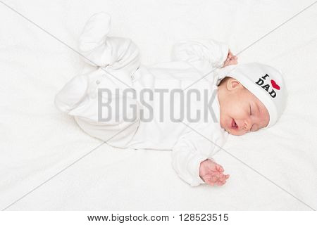 Cute baby sliping on the white cloth