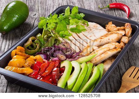 Delicious Chicken Fajita Platter with Avocado Bell Pepper Red Onion and Cilantro close up top view
