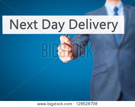 Next Day Delivery - Businessman Hand Holding Sign
