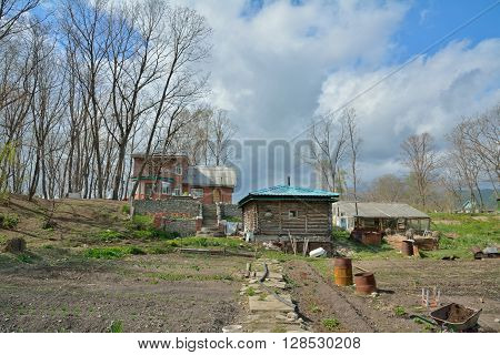 The country-cottage with vegetable-garden and bathhouse. Russian Far-East.