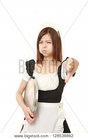 young Japanese woman wearing french maid costume with thumbs down gesture