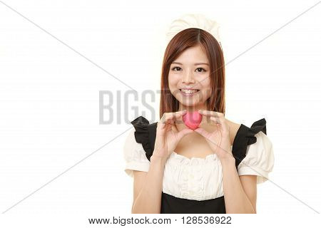 young Japanese woman wearing french maid costume with pink heart