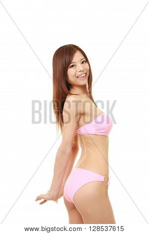 portrait of young Japanese woman in a pink bikini