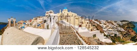 Picturesque panorama, Old Town of Oia or Ia on the island Santorini, white houses and church with blue domes, Greece