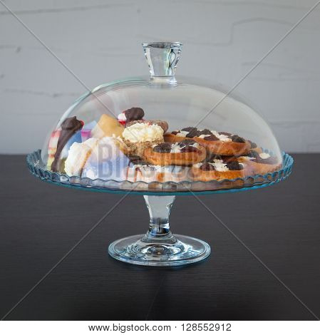 cakes and sugar in a glass doze on black wooden table