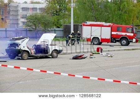 CZECH REPUBLIC, PLZEN, 30 SEPTEMBER, 2015: Simulation of a car accident. Firefighters and rescuers are helping injured person by the car accident.