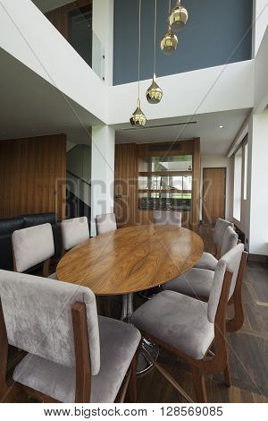 table in open plan living room of a luxury duplex apartment poster