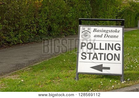 BASINGSTOKE UK - MAY 5 2016: A sign pointing towards a polling station in the Hampshire borough of Basingstoke and Deane on election day.